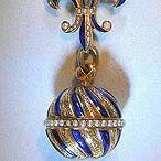 Fine Swiss 18K gold, enamel and pearl bezel-winding ball watch with matching pin, circa 1900.