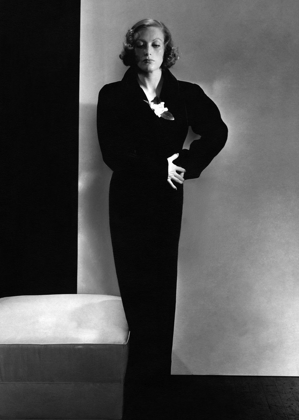 Joan Crawford wearing a dress by Elsa Schiaparelli in a 1932 photo by Edward Steichen for Vogue