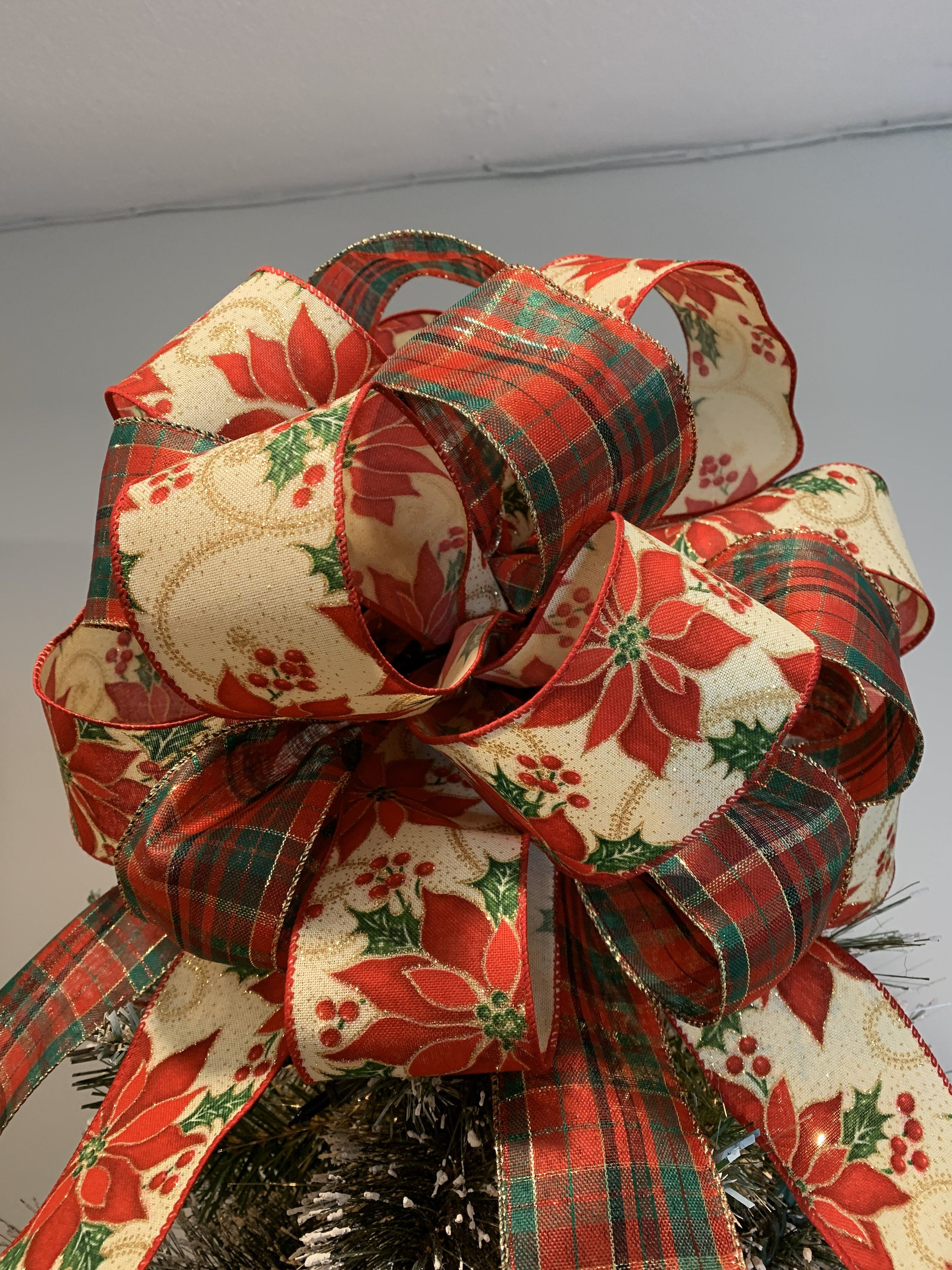 Large Christmas tree topper bow made with a red and green