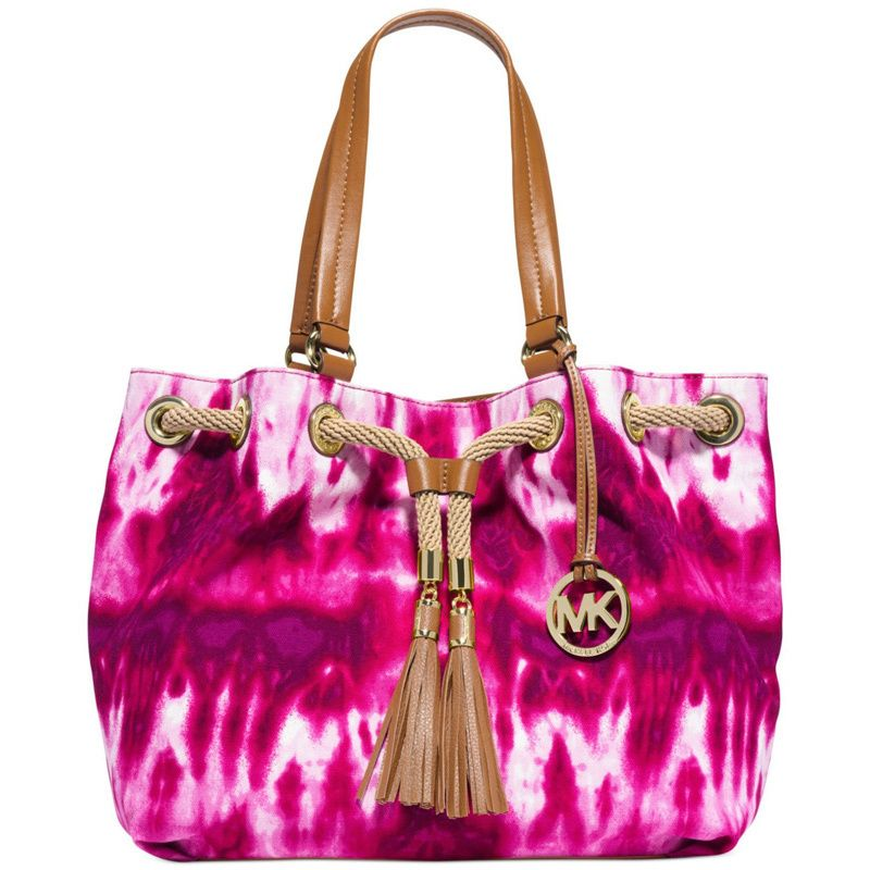 Store your belongings in this unique tie-dye pattern Michael Kors tote. Featuring a drawstring top with fringe tassel details, this handbag has a spacious main compartment for all of your daily essentials.
