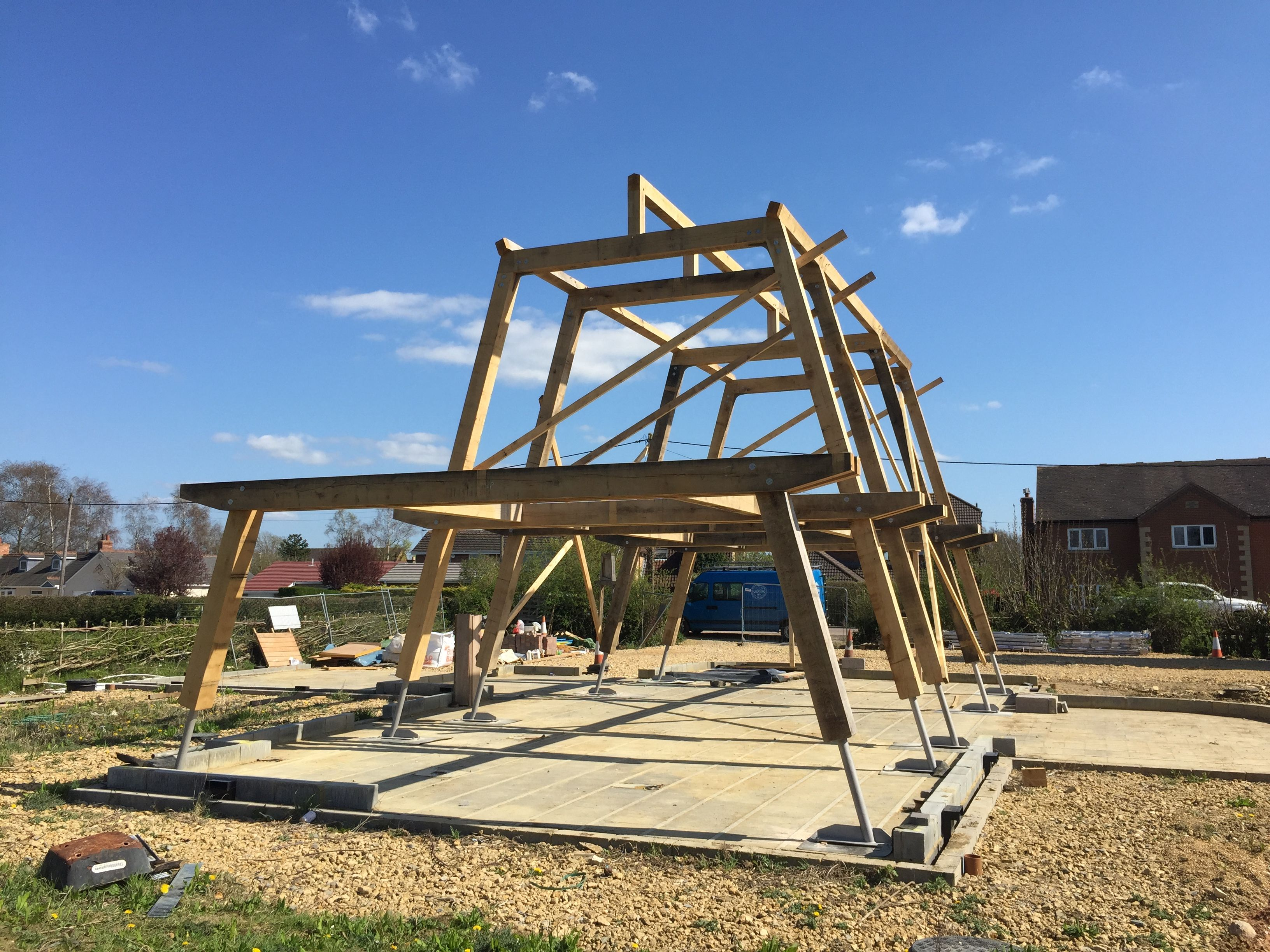 An oak frame just erected in Northamptonshire. By Roderick James Architects and Carpenter Oak Devon.