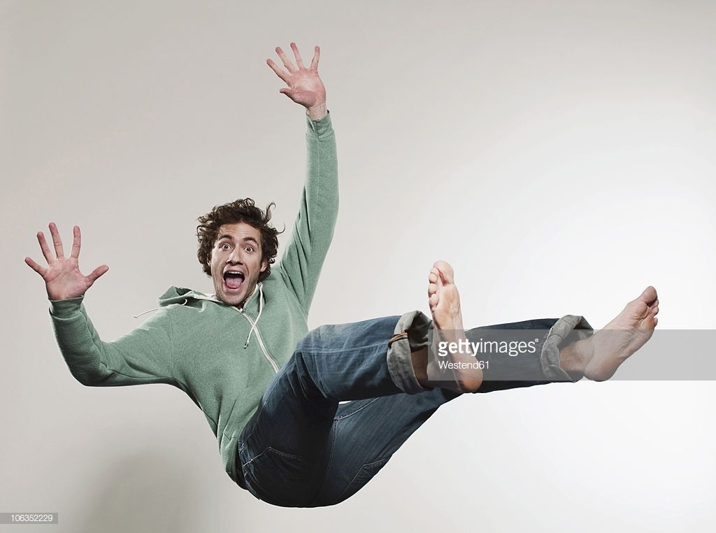 Stock Photo Man Falling Against Grey Background Mouth Open Portrait Pose Reference Photo Gray Background Funny Photography