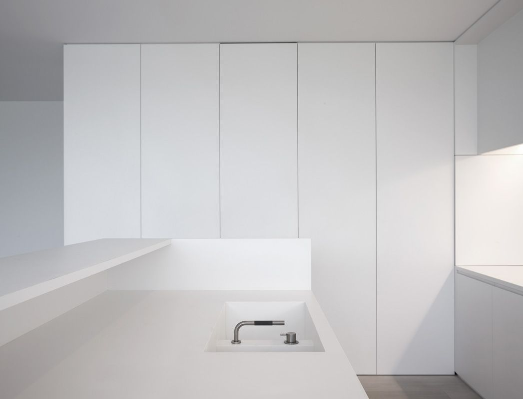All white custom made kitchen by minus architects. interieur