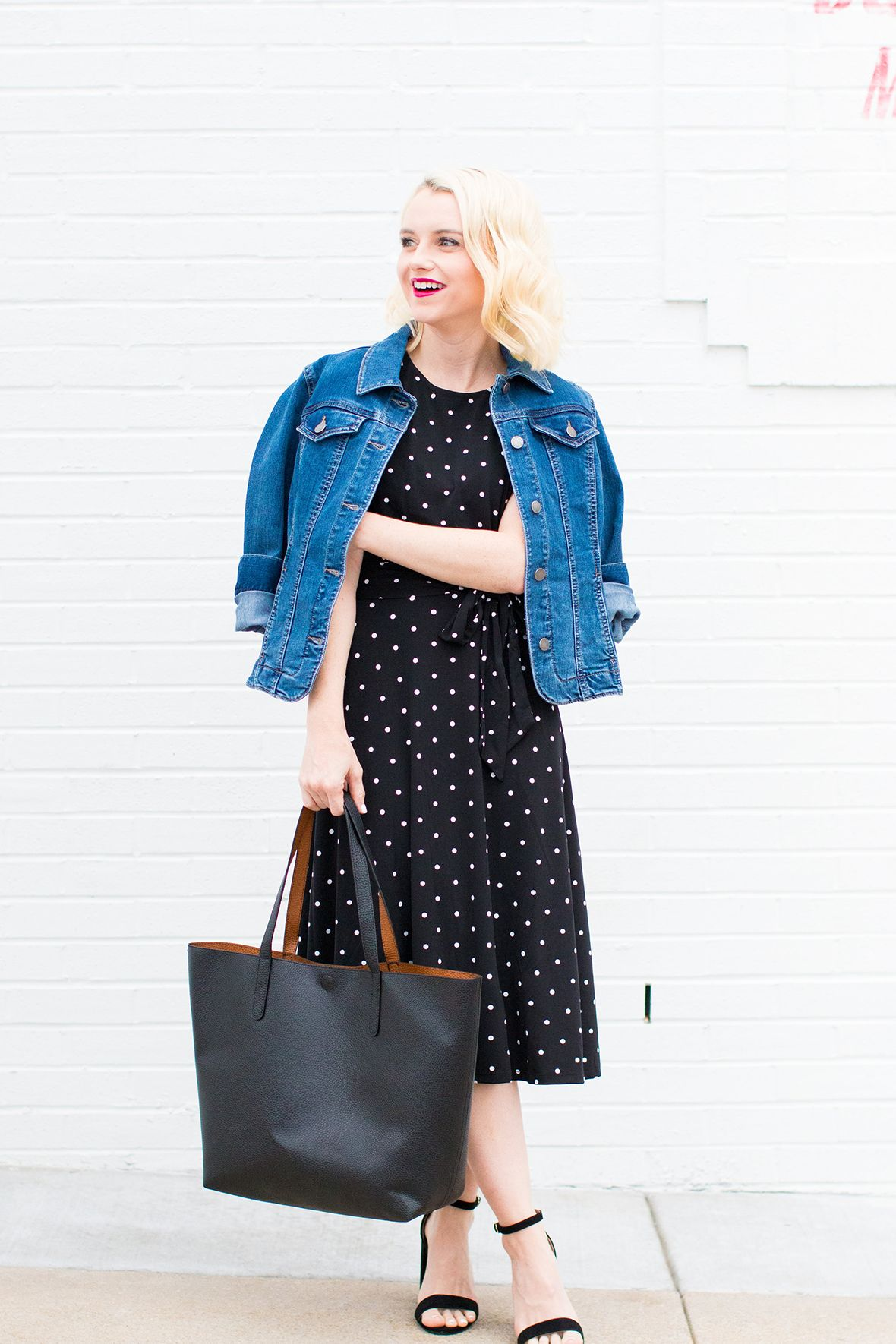 Poor little it girl. Black midi dress with white polka-dots+denim jacket+black ankle strap heeled sandals+black tote bag. Summer Outfit 2016