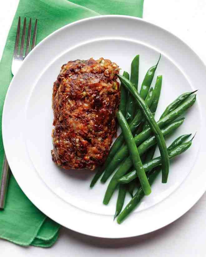 This easy ground-beef recipe is perfect for when you crave the flavors of meatloaf but are cooking for one. This dish is flavored with cheddar cheese, but feel free to try other combinations, such as pork and beef with Gruyere or Monterey Jack cheese. Steamed green beans are served alongside for a quick solo dinner.