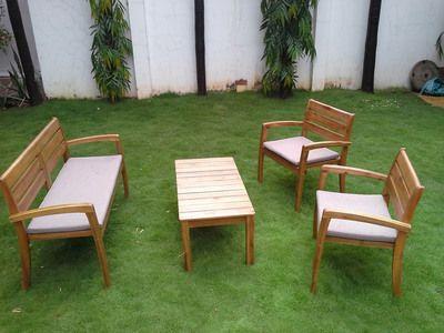 Salon de jardin 4 places en acacia : 1 table basse + 1 canapé + 2 ...