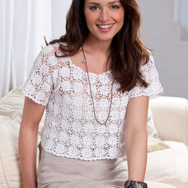 Top off anything from a dressy skirt to casual jeans with this classic lacy top. Crocheted with size 10 crochet thread, it's the ideal project for taking along for productive relaxation