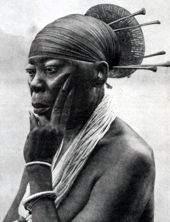 Africa | Queen Nenzima of the Mangbetu people of Congo. || From the Secret Museum of Mankind Volume 2. Published 1935
