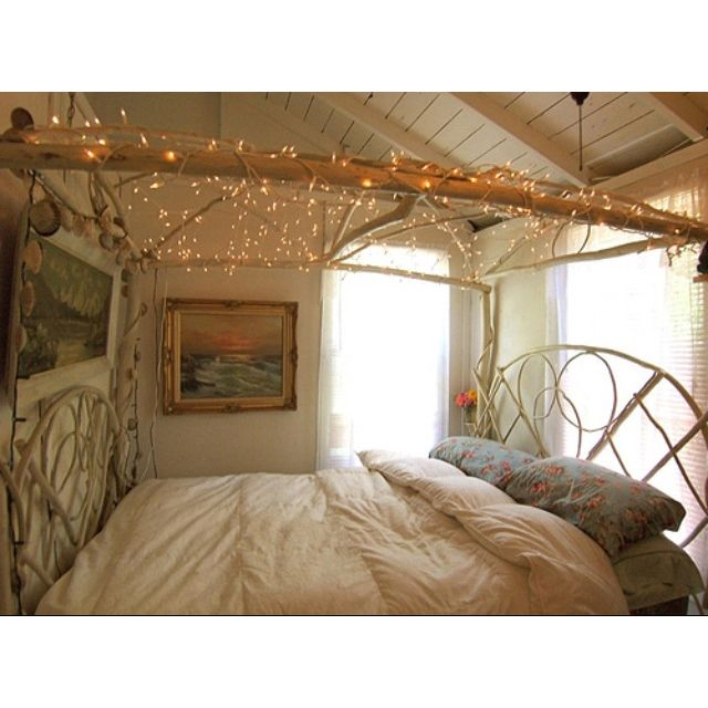 Make canopy type thing out of sticks & small logs. Hang lights ...