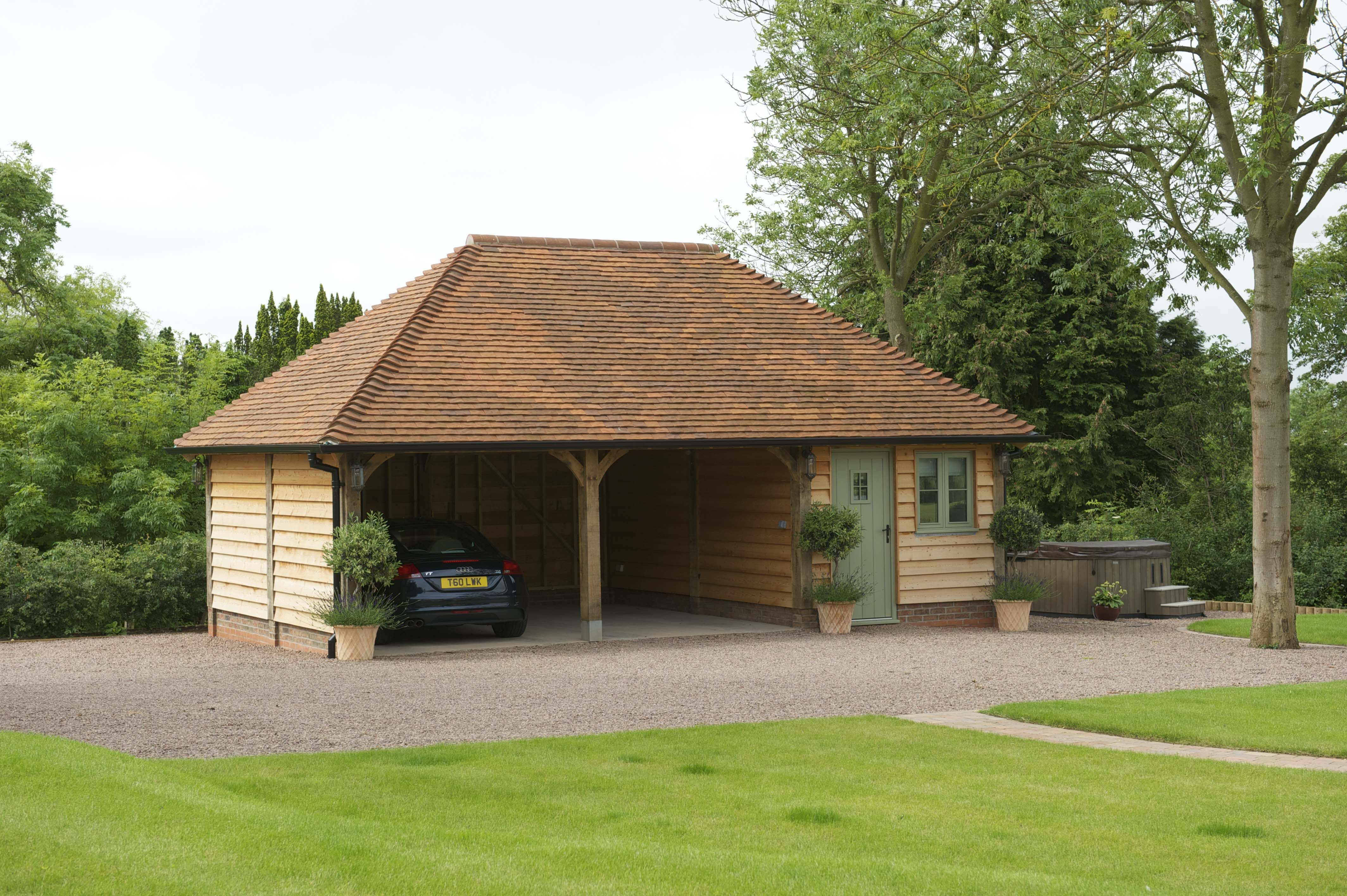 Border Oak Oak framed Garage with hipped roof and home