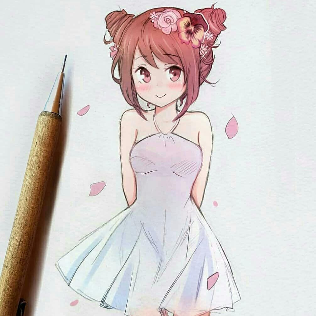 A cute bun haired girl with an ombré dress and petals
