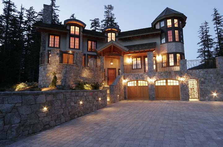 gorgeous house, love the rock exterior and the turret on the side