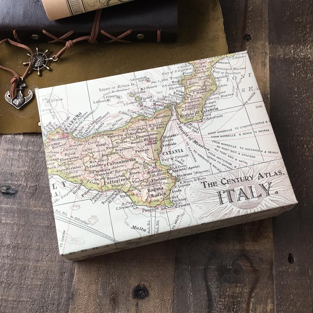 A mini weekend project: wrapping an old hinged skincare gift box with some cartography wrapping paper that's been lying around collecting dust. Yay to new things made from old. . . .