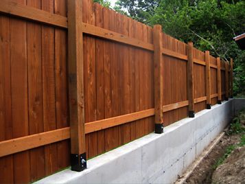 Image Result For Landscape Retaining Walls With Fences Installed Ontop Concrete Fence Posts Concrete Fence Fence Design