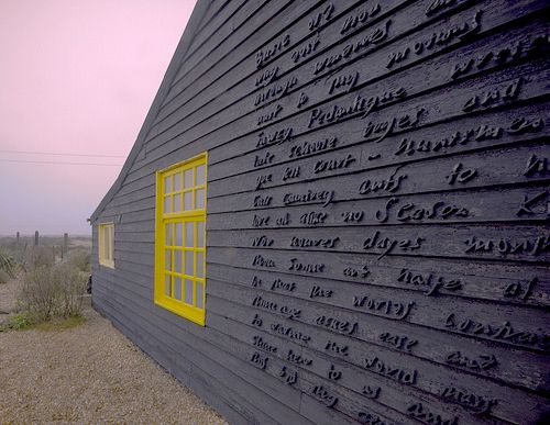 Exterior wall of Derek Jarman's Prospect Cottage, showing John Donne's poem 'The Sun Rising' -- originally installed by Peter Fillingham and later restored by Charlotte Moth.  via chelseaspace.org