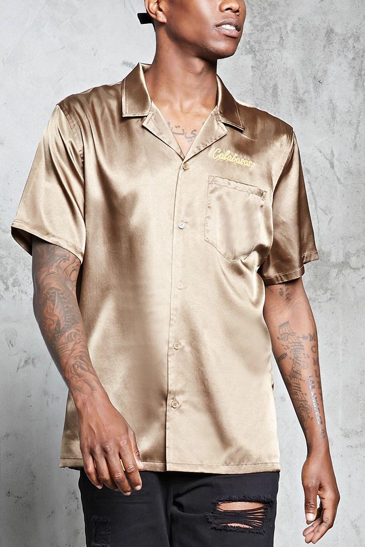 8f6cfeacd A woven satin shirt featuring a
