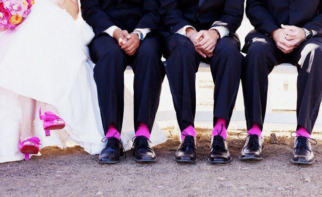 Cute shot of wedding party bride's fuschia shoes and groomsmen socks