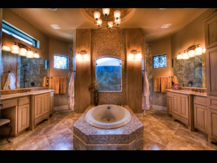 Walk-in shower at the back. Totally His/Her master bath..Another Jimmy Jacobs.