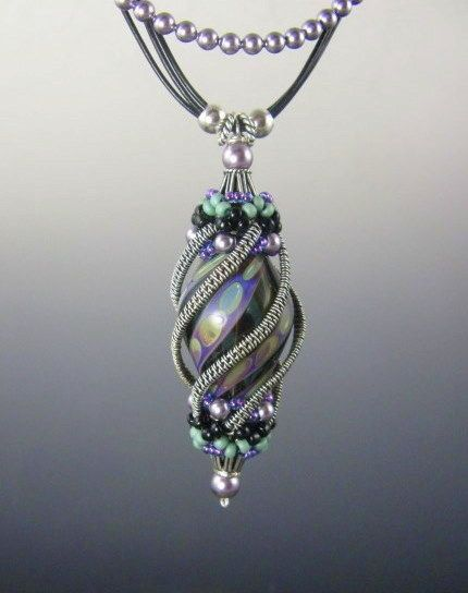 This wire wrapped necklace is absolutely stunning. I wish I could find the original image to give due credit, but a search came up empty.
