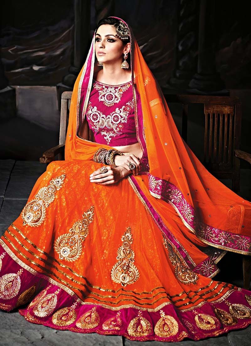 Wear to wedding dresses  Glowing Ravishing Orange Net Lehenga Choli Product Code  shop