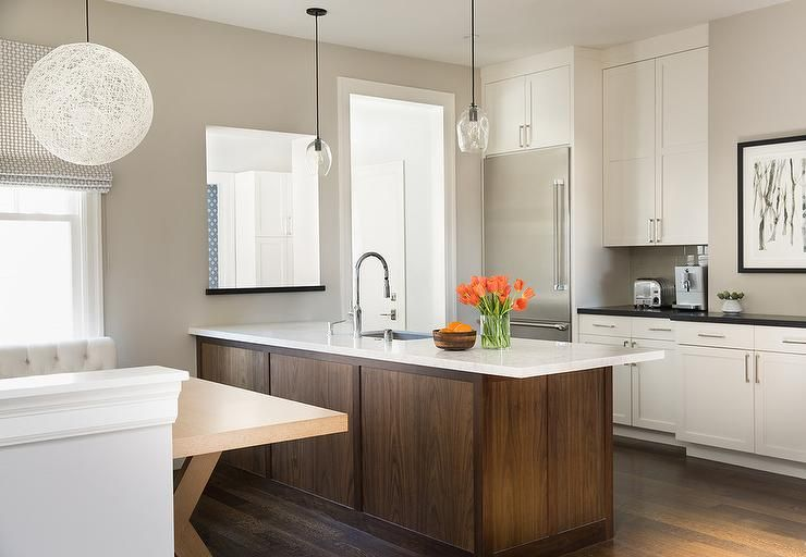 Stunning Two Tone Kitchen Boasts A Coffee Stained Kitchen Peninsula Accented With A Whi White Modern Kitchen Kitchen Cabinet Remodel White Kitchen Cabinets Diy