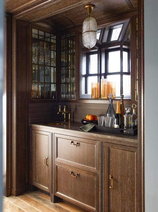 in a wood clad alcove light brown cerused oak bar cabinets are fitted with gold hardware a on kitchen cabinets gold hardware id=61376