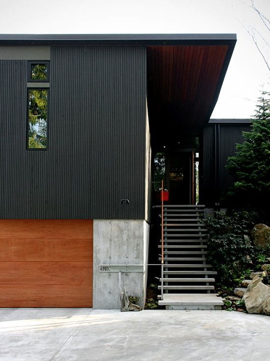 Vertical Small Pattern Metal Siding Paired With Concrete