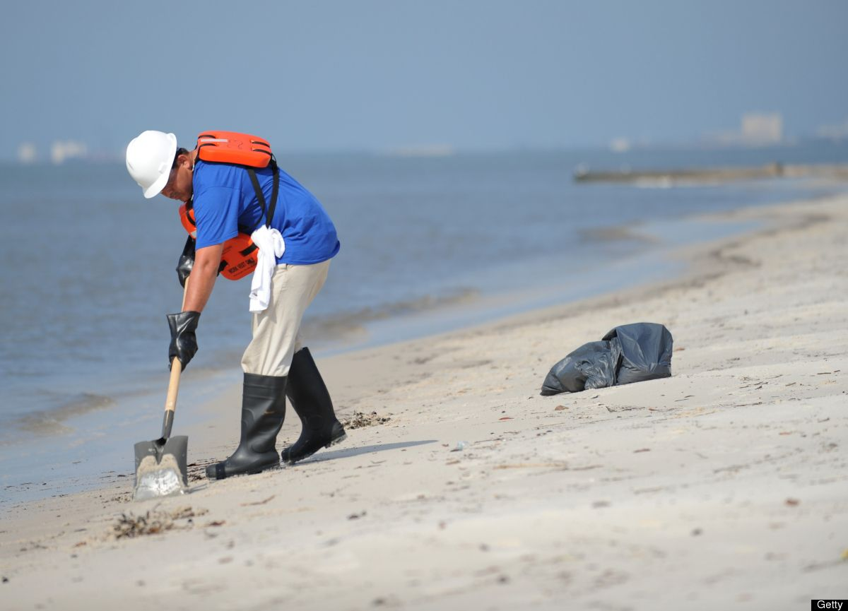 A man cleans a beach May 4, 2010 in Bilo