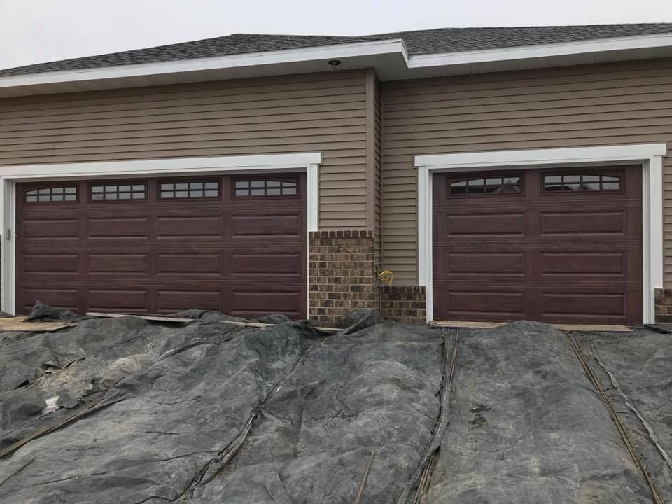 This Is C H I Overhead Doors 4283 R Value Of 9 65 Mahogany In Color With Arched Stockton Windows Overhead Door Painted Front Doors House Front Door