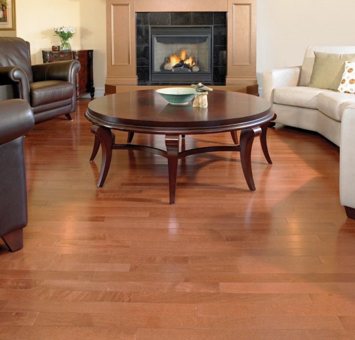 Living Room Idea With Hardwood Floor VS Laminate And Round Coffee