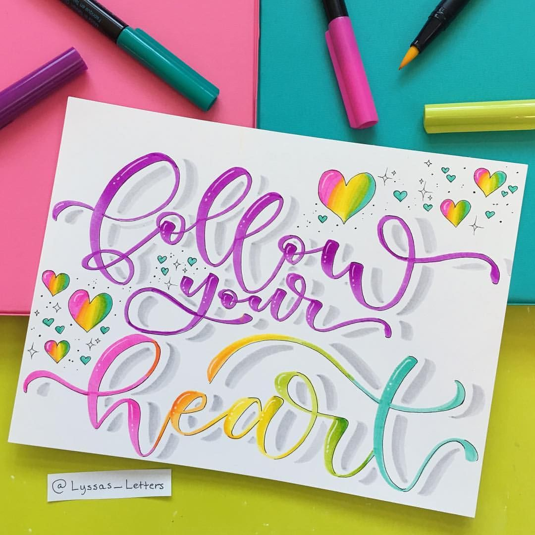 An Inspirational Handwritten Quote With Rainbow Hearts