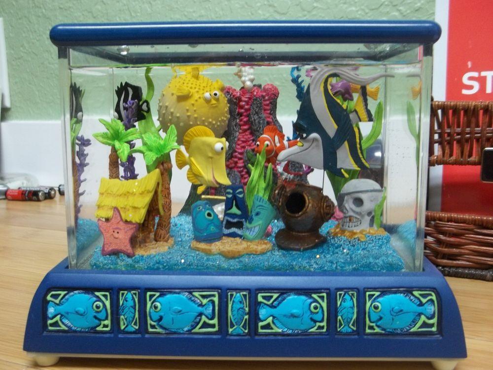 Rare finding nemo disney store fish tank gang snowglobe for Disney fish tank