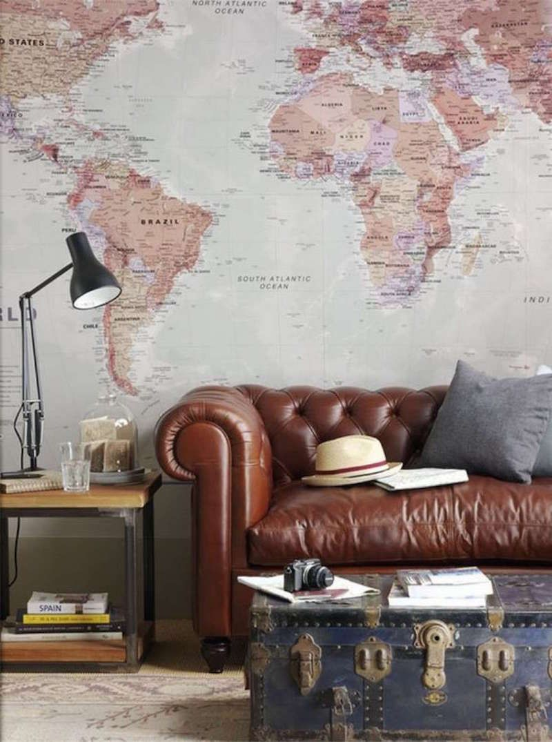 beautiful brown leather sofas vintage trunks wall maps and
