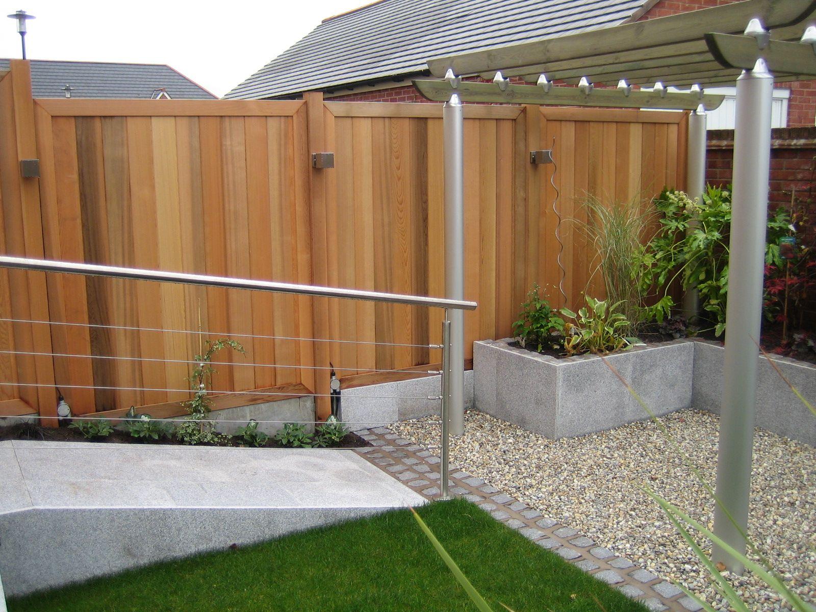 Contemporary cedar fencing panels from a garden designed ...