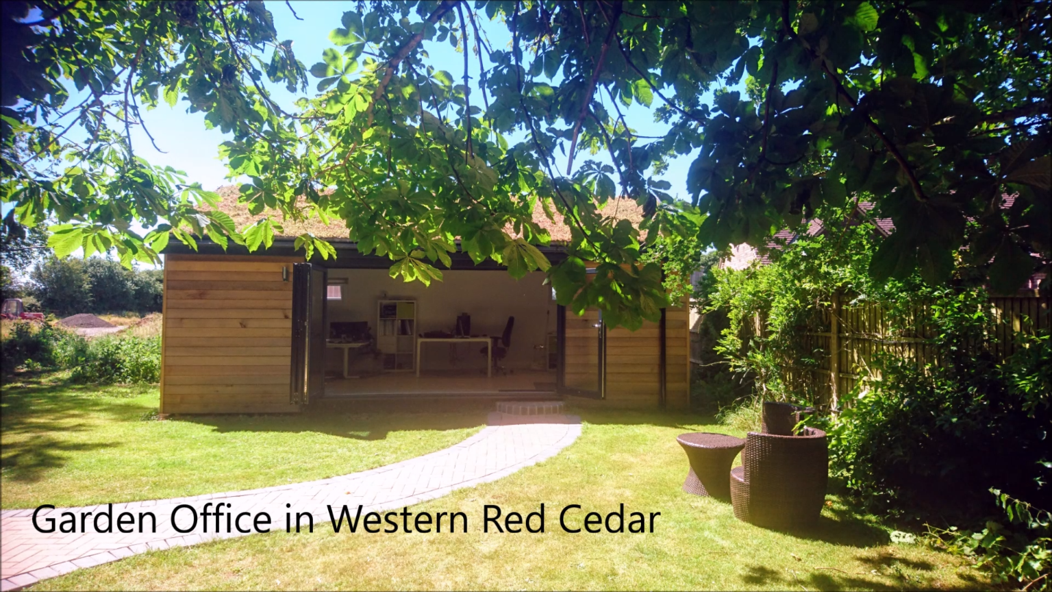 Western red cedar garden office with living sedums roof and