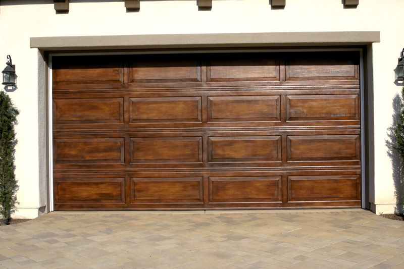 Have Your Garage Door Faux Finished To Simulate Wood Yes Most Of These Photos Are Standard Metal Faux Wood Garage Door Wood Garage Doors Garage Door Paint