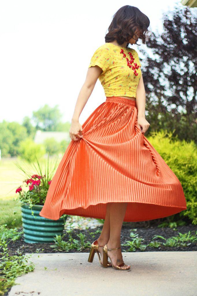 orange skirt, yellow top.