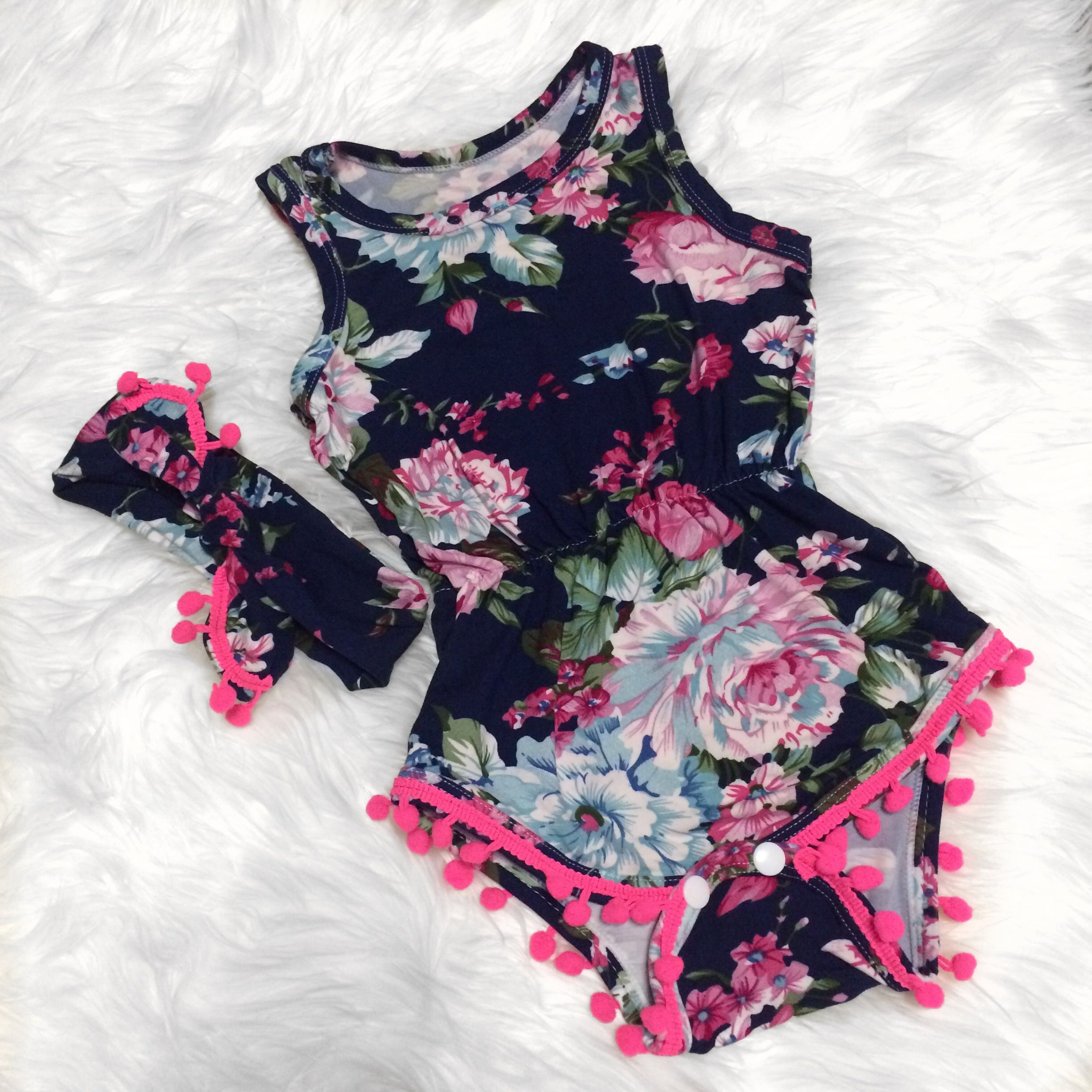 Our Fancy Floral Pom Pom Romper & Headband Set is a must have for