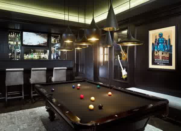 Interior black themed room with various pendant lamps dark interior black themed room with various pendant lamps dark colored modern billiard table and posters aloadofball Image collections