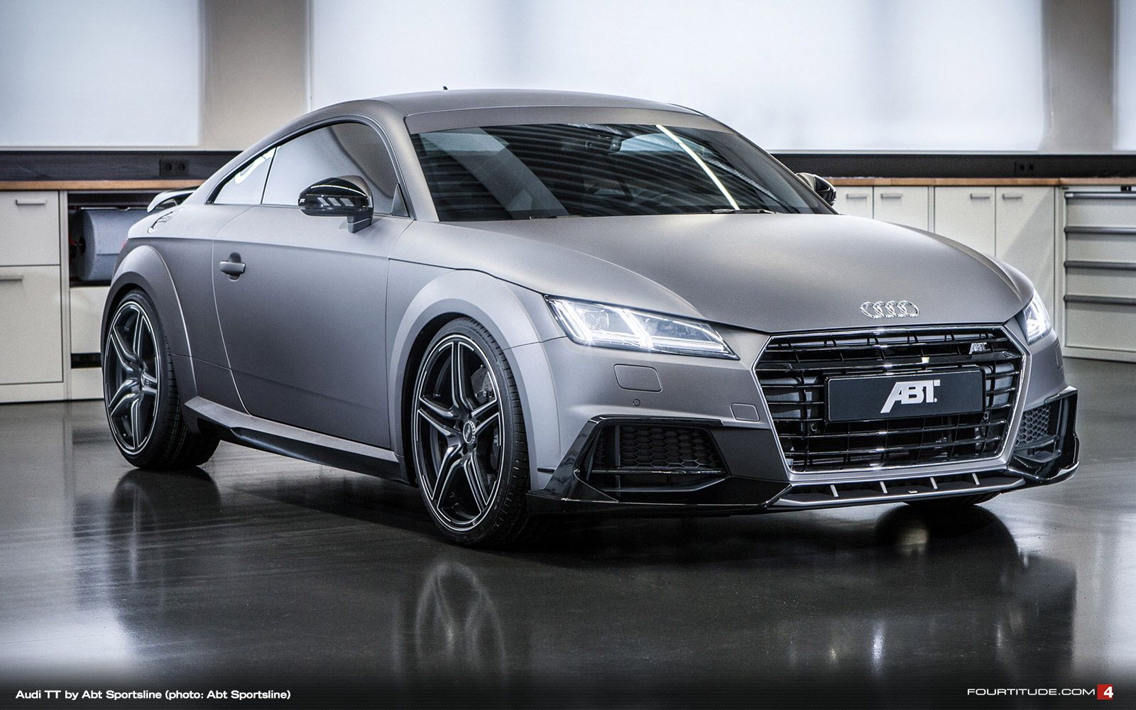 """The matt wrap in """"gunmetal"""" makes the new Audi TT come into its own. Combined with the body parts by ABT Sportsline the sport coupé from Ingolstadt becomes as assertive as it becomes a super sports car. """"And this means there has to be power and performance,"""" says CEO Hans-Jürgen Abt: """"With this exhibition model we show how much potential there is even in the 2.0 TFSI quattro, which we have upgraded to the level of the production TTS."""""""