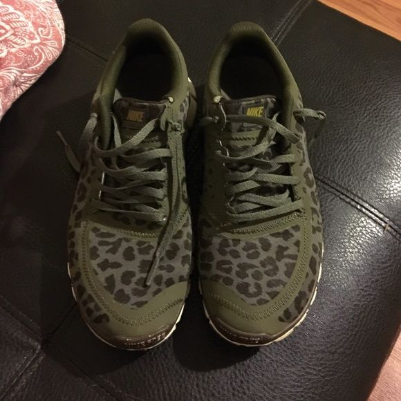 Leopards · Nike tennis shoes Nike Free 5.0 size 8. They are a army green  leopard print