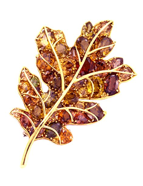 Iconic leaf brooch by Verdura, who was one of Americas' most important jewelry designers. The stones capture the beauty of an Autumn leaf perfectly.