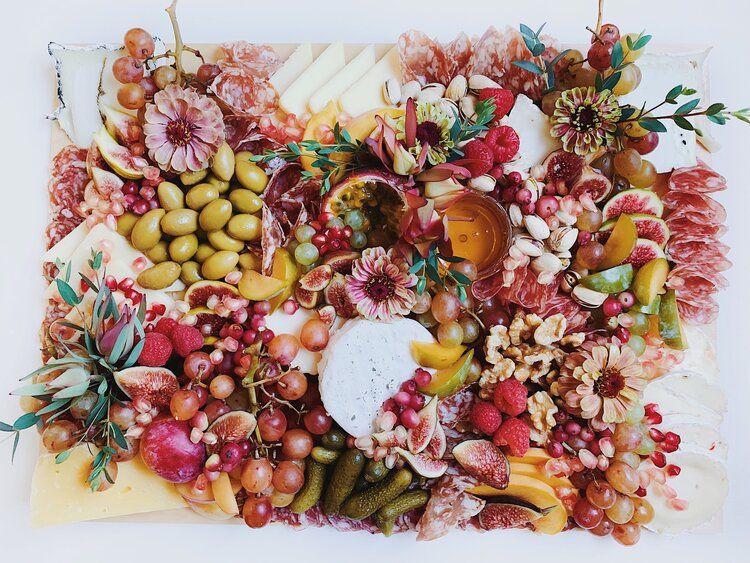 Cheese charcuterie board fruit in season artisan