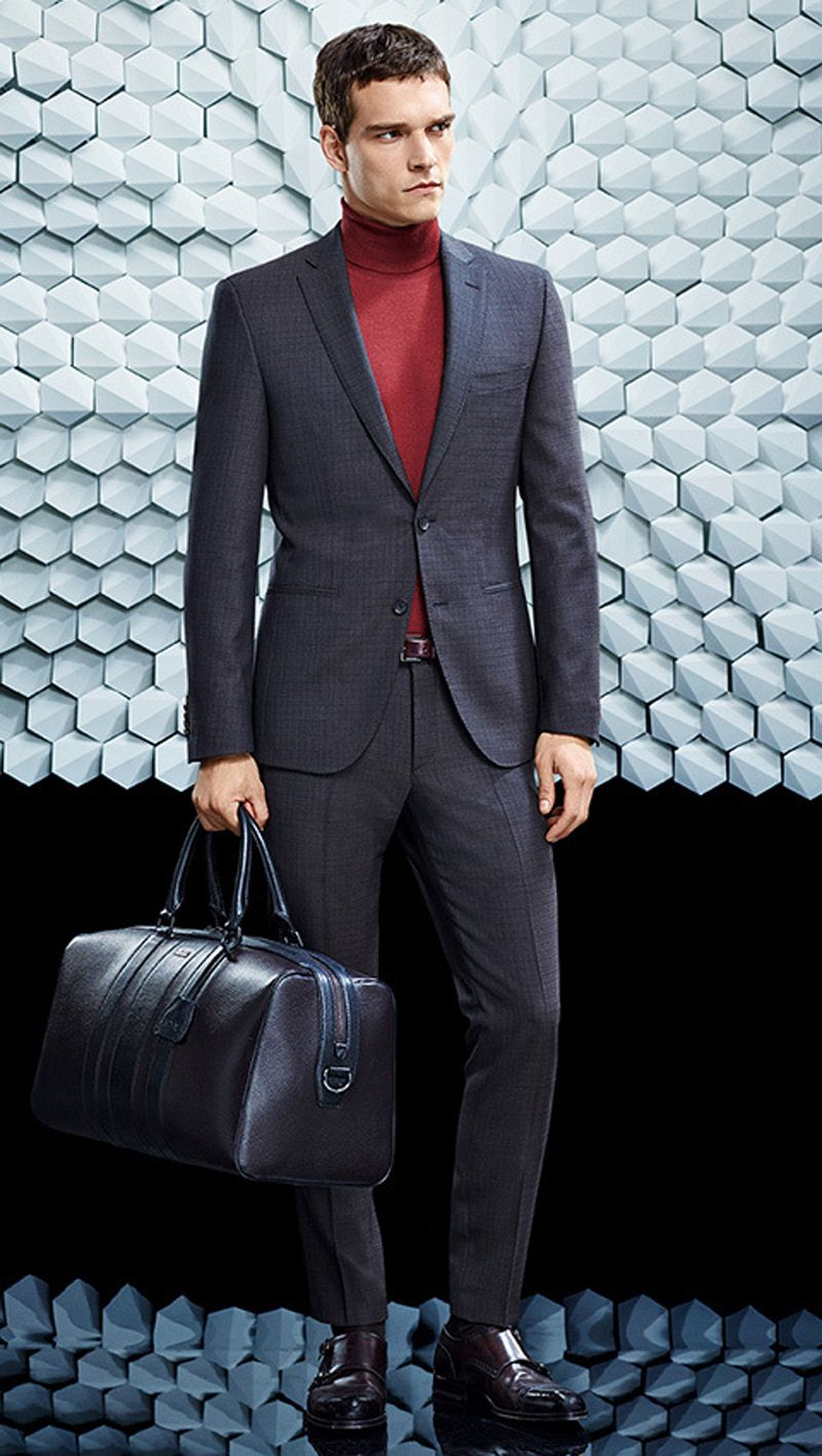 757126a433a5 Look the best you possibly can in a charcoal suit and a red turtleneck. Dark