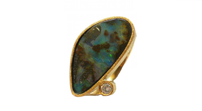 Anillo ópalo boulder australiano y diamante talla brillante en oro amarillo