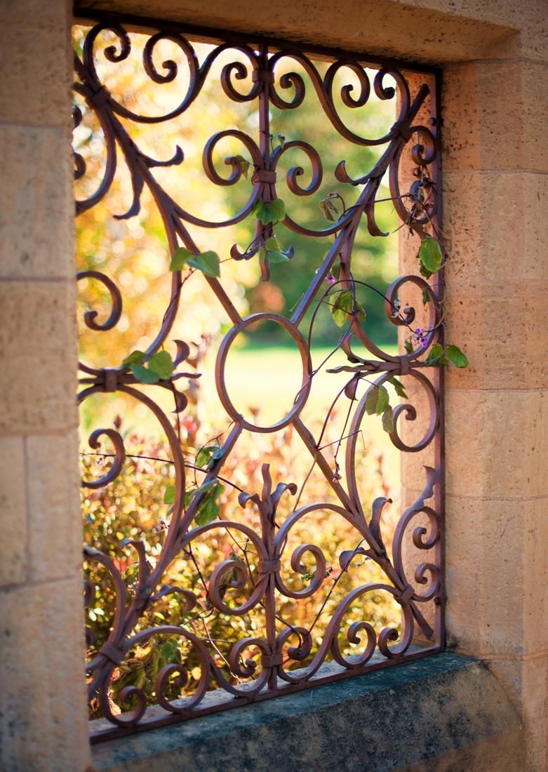 This wrought iron window is purely a decorative feature built into a ...