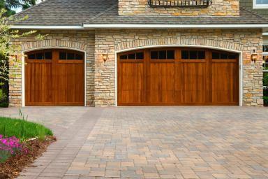 Concrete Pavers Are A Good Alternative To Poured Concrete Garage Doors Garage Door Design Paver Driveway