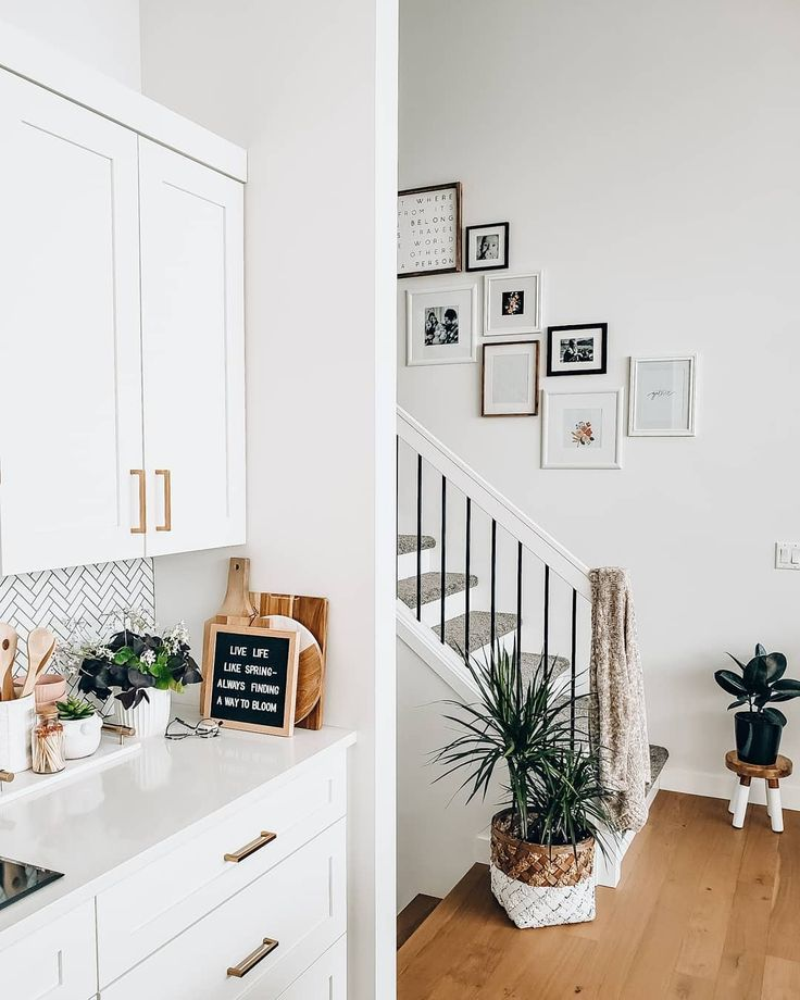 Beautiful white kitchens & an eclectic gallery wall up the ... on Traditional Kitchen Wall Decor  id=72682