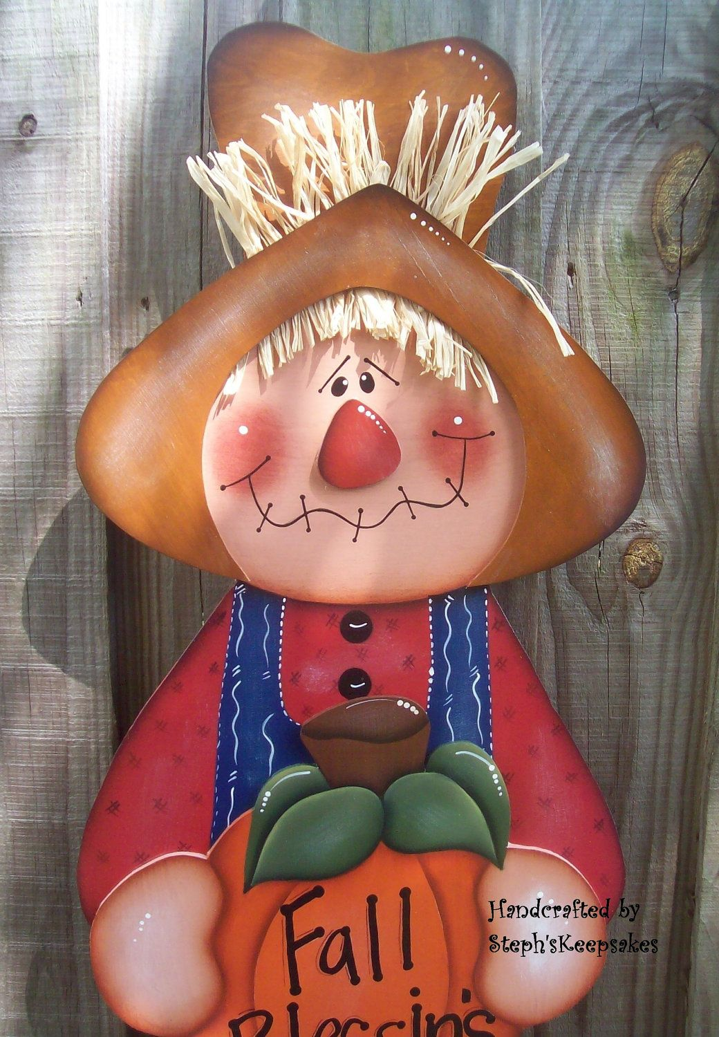 Wooden Scarecrow ,Wall Hanging, Fall, Autumn, Home decor, Holidays, Hand painted Wood Sign, Fall, Thanksgiving, Greeting, Fall, Harvest. $43.95, via Etsy.
