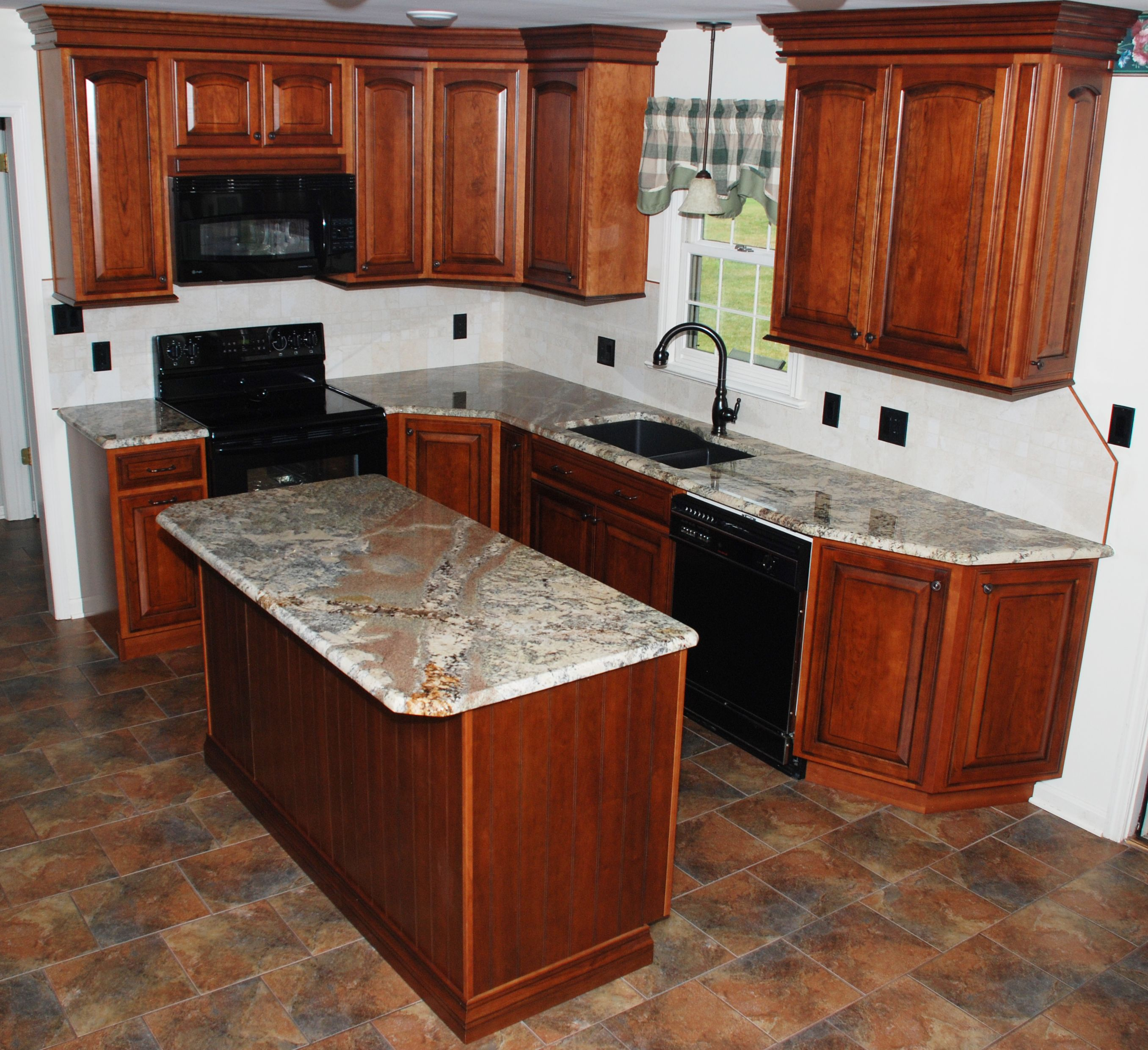 the vein of this river bordeaux granite counter top flows across the vein of this river bordeaux granite counter top flows across the island and into the